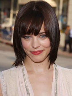 midi layered hairstyle with bangs